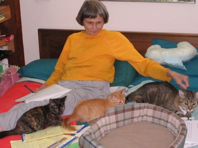 Rhea White and 3 of her Cats